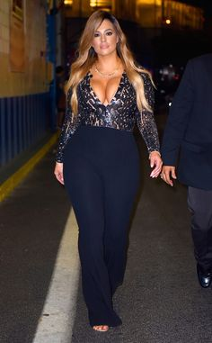 Ashley Graham has left us speechless. The supermodel's perfectly-fitted navy blue Michael Kors jumpsuit hugs her curves in all the right places and while she's showing a lot of cleavage, the full-length sleeves compliment the super-sexy low-cut neckline. Perfection.