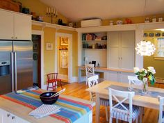 Recently completed yellow and white kitchen.