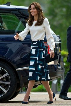 The Duchess wearing a white blouse by Goat and a patterned midi skirt by Banana Republic
