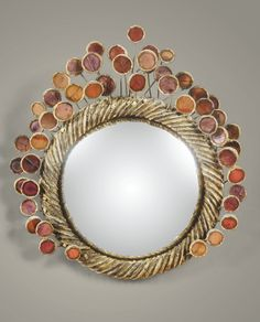 LINE VAUTRIN 1913 - 1997 MIROIR SORCIÈRE PERRUQUE, VERS 1965 'PERRUQUE', A BROWN TALOSEL RESIN MIRROR BY LINE VAUTRIN, CIRCA 1965. SIGNED AND STAMPED 'ROI' de forme circulaire en talosel incrusté de miroirs dans les tons orange, violine et rose Signé Line Vautrin et porte le cachet Roi au revers  Diamètre : 22 cm (8 1/2 in.)
