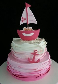 Ruffle boat anchor baby cake. Love that a nautical can be used for a baby girl and not always a boy.