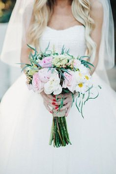 A romantic white and pink bouquet | Brides.com