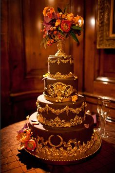 Gorgeous cake using gold colored sugar paste and molds from www.sugarartmolds.com