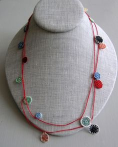 normally I am not for crochet/knit jewelry, but this is delicate and sweet