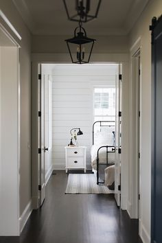 Benjamin Moore Simply White Shiplap Paneling Paint Color with Simply White Trim and Dark Hardwood Flooring Hardwood Floors In Kitchen, Dark Hardwood, Engineered Hardwood, Painted Hardwood Floors, Kitchen Floor, White Shiplap Wall, White Walls, Benjamin Moore, Oak Bedroom Furniture