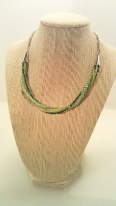$13.50 Much like our past Green Twist Necklace only in choker style!    This Hand-Beaded Green Glass & Silver Choker is one of our most popular items! This wonderful necklace is excellent for everyday wear. It measures just about 16 inches around...not too short and not too long! A must-have for your accessory collection!    We also offer a beautiful matching Bracelet! http://www.etsy.com/listing/95100952/green-glass-bead-and-silver-twist