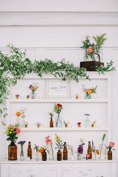 Eclectic mix of medicine bottles and vibrant flowers come together for a wildly wonderful display #cedarwoodweddings Wild and Free Wildflower Wedding :: Brooke+Jake | Cedarwood Weddings