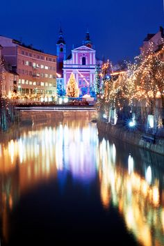 Christmas decorated Slovenian capital Ljubljana with Franciscan Church of the Annunciationat.
