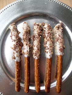 Chocolate dipped Pretzel Rods.  Sprinkle with crumbled Heath bars, Butterfingers, nuts, Oreo's, etc....!
