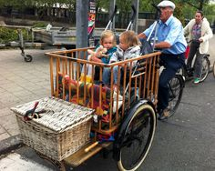 One of the many creative bikes on the streets of Amsterdam. This one seems to be an antique crib mounted on an antique bakfiets chassis. I'm guessing that's opa (grandpa) www. Tricycle, Dutch Bicycle, Velo Cargo, Going Dutch, Voyage Europe, Bike Style, Amsterdam Netherlands, Tandem, Windmill