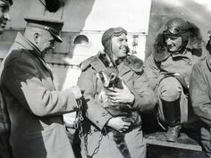 A few pilots hanging out with a pet raccoon (don't try this at home!), 1926