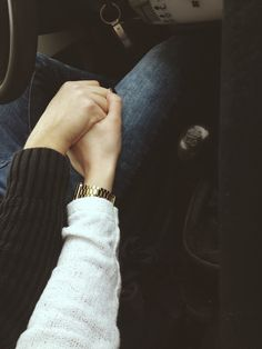 so many pictures of holding hands in the car and yet they never get old