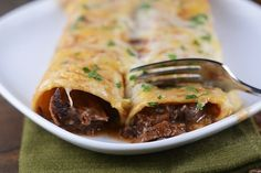 Get this recipe for slow cooker Mexican beef! The super tender, shredded beef is perfect for enchiladas, burritos, salads, and the list goes on and on!
