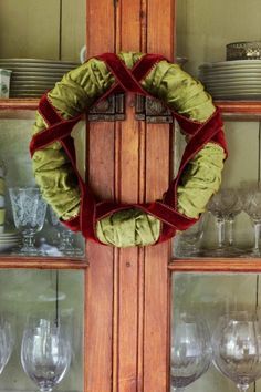 How to make a festive wreath with leftover fabric scraps or old sweaters, threaded on a styrofoam wreath.