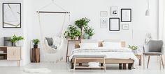 Buy Spacious natural bedroom with hammock by bialasiewicz on PhotoDune. White fur on bench in spacious natural bedroom interior with hammock, king size bed, plants and posters Le Style Zen, Wooden Bench Plans, Hammock In Bedroom, Deco Zen, Chic Antique, Natural Bedroom, Style Deco, Washable Rugs, Home Accessories