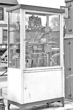 "Standard Oil Gasoline station 1939, This image gives a rare view of the automobile sundries sold from this lighted display cabinet. The top shelf features a Champion advertising piece, and it and the second shelf have a display of the makers spark plugs. The third shelf carries EZ1 chrome cleaner and a Johnson's wax product. The forth shelf contains Warner ""Radiator Cleaner,"" and ""Liquid Solder"" radiator stop-leak."