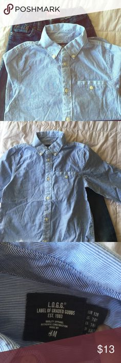 BLUE PINSTRIPED BUTTON DOWN SHIRT This is a blue pinstriped button down, long sleeve shirt. Excellent quality. Perfect for layering this fall. Will fit 7-8 or medium. H&M Shirts & Tops Button Down Shirts