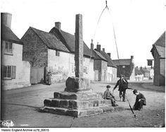 CC79/00515 Two children and a man wearing a wooden leg beside the village cross on Main Street,  Frisby On The Wreake, Leicestershire.  14 Mar 1885 Photographer: London Midland and Scottish Railway.  Please click on the image for more information or to search our catalogue for other images. Wooden Leg, The Far Side, Historical Images, Main Street, Maine, Louvre, England, London, Woman