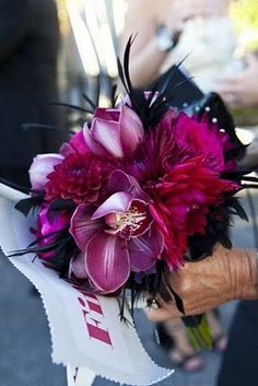 Black feathers mixed with purple orchids