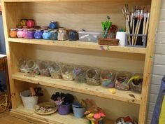 let the children play: Reggio-inspired preschool ateliers I love the glass candy jars for mixed media materials.