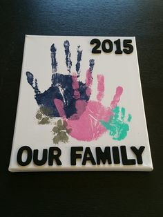 Beautiful family hand print wall art. A fun 2017 diy project. Don't forget fido.