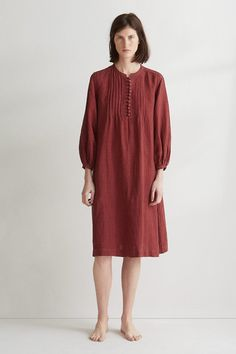 LINEN SMOCK DRESS | Supple, garment dyed linen. Easy, smock-ish cut. Wide, balloon-ish, gathered sleeves with buttoned cuffs. Rounded buttons. Sewn-in pleats either side of collar. Sewn-in pleats into back yoke. Hanging loop at back. Pockets.