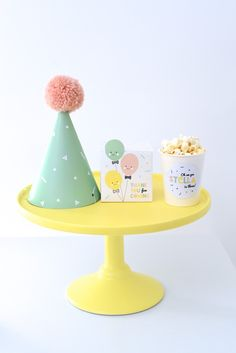Little Paper Plate Events: Oh em gee Stella is three! balloon party, little paper plate events, Robert Gordon Australia cake stand, yellow cake stand, park hat, mint Green Party hat, Pom Pom, lolly box, popcorn, Nina Designs, Kids party ideas, children's party ideas