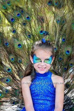 good peacock makeup idea for halloween Girls Peacock Costume, Peacock Halloween Costume, Halloween Costume Contest, Halloween Costumes For Girls, Girl Costumes, Halloween Kids, Costume Ideas, Costume For Kids, Peacock Dress