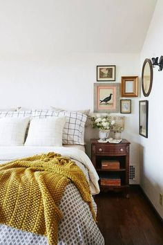 cozy bedroom, bedding, simple, mustard, home, interior, frames, gallery wall