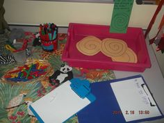 Minibeast acitivites - toys, measuring/writing about snakes, snake pattern threading, snake paperplates