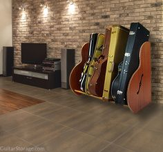 here's a collection of #guitars nicely organized thanks to the Deluxe Mahogany Guitar Case Storage Rack. view details here: http://guitarstorage.com/shop/mahogany-guitar-case-racks/