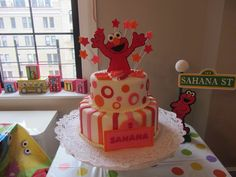 Girls Elmo inspired Fondant  Cake Toppers Complete Set Cake Decorations. $24.95, via Etsy.