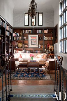 The library's club chairs are from a Paris flea market | archdigest.com