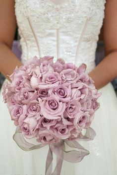 Gorgeous lilac rose bouquet goes with her beautiful dress.
