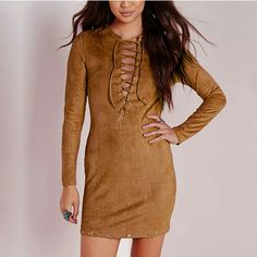 Cognac Brown Suede Lace Tie Up Grommet Dress This dress is gorgeous and perfect for fall! A rich cognac tan brown faux suede dress with suede lace ties and grommet accents. Full sleeves.  - 95% Faux Suede / 5% Polyester - Non-stretchable material - Back Zipper - Imported - Hand wash cold  NO TRADES! Dresses Long Sleeve