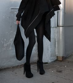 Black pea-coat/coat goes with everything ^_^ [if your closet is 90% black, 5% faded black, and 5% white like mine] lol     OR    A black mini-waist length jacket [possibly even a similar length coat but instead a different fabric-in grey] <3