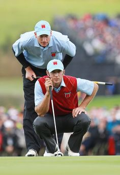 DJ and Jim Furyk line up a putt at the Ryder Cup