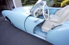 1954 Kaiser Darrin Roadster, showing  sliding 'pocket' door...... I saw one of these in the Santa Barbara Fiesta parade back in the late 50's.