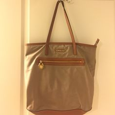 Authentic Tan Michael Kors Tote Gently used condition, although does have some visible water spots on the back of the tote. Nothing unbearable, still looks very nice! MICHAEL Michael Kors Bags Totes