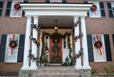 Triple Wreaths - 60 Beautifully Festive Ways to Decorate Your Porch for Christmas - I like the way the wreaths are hung on the windows.
