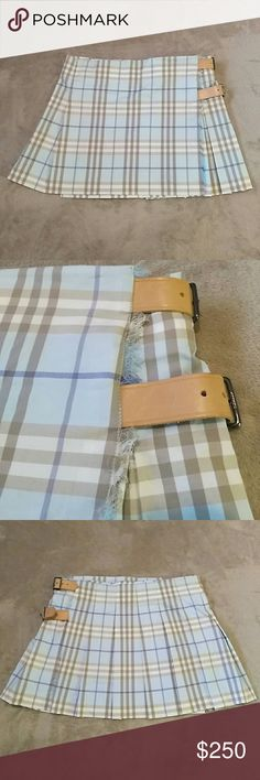 Blue Burberry Pleated Kilt Mini Skirt Sz 12 Authentic Burberry blue/tan/white plaid pattern skirt with tan leather buckles and Velcro band for adjustable and suitable for multiple sizes. Purchased brand new with tags and only worn a few times so it is in excellent condition, now I'm just trying to minimize and this no longer fits. Burberry Skirts Mini
