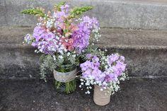 vintage lavender purple centerpiece mason jar, twine, burlap, lace wild flowers babies breath  http://sophisticatedfloral.com/users/awp.php?ln=110659