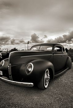 Classic Car  form photography   the car is parked at an angle that makes it look like you can open the hood and look in