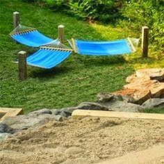 I've never thought of using something like boat dock piers or railroad ties for hanging a hammock.