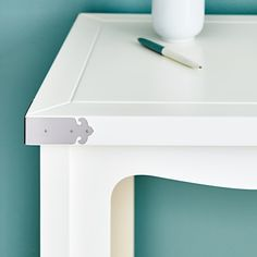 small metal accents on the white lacquer michiko console bungalow 5 white lacquered