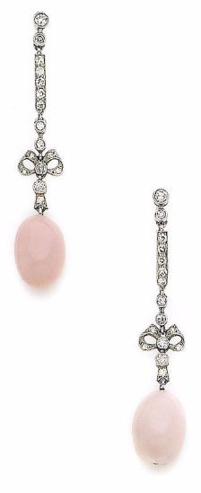 A PAIR OF BELLE ÉPOQUE CONCH PEARL AND DIAMOND PENDENT EARRINGS, circa 1905  Each conch pearl suspended from an articulated bow motif and bar-link set with single-cut diamonds, length 4.3cm