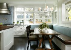cottage style kitchen with built in bench for seating.