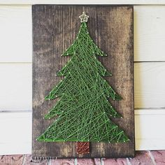Christmas Tree String Art Sign. This listing is for a made to order string art sign measuring approximately 17 x 12 Board will be stained Walnut with a green tree and gold star, unless otherwise requested. Please list your color choice in the Note to Seller if youd like something different than whats pictured. You can find color options for the string and wood in the last photo. Numbers on the chart for the string can be hard to read, so if you have any questions (or would like any help)…