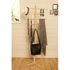 The floor stand is made from hand turned natural blonde wood. Featuring a stainless steel leaf at the top. This stand measures 180cm tall and 74cm wide. The stand is flat packed with instructions for easy assembly. The arms can moved to suit what you are hanging so is perfect for necklaces, bags and scarves!