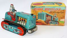 ULTRA RARE Vintage Battery Operated Tin Lithographed #115 ROBOT BULLDOZER, Japan, United Pioneer Co. / A Flare Product. This is a scare robot to find! Perfect working order! Comes with tractor, driver